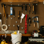 An ordered workshop with tools hanging on the wall